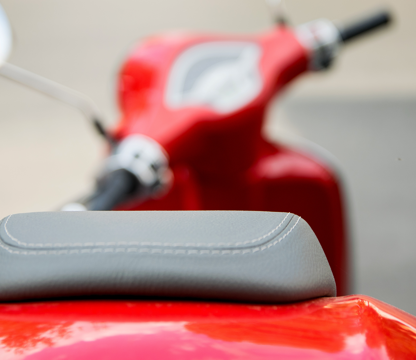 Photo of a red scooter.